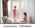 two girls looking out the... | Shutterstock . vector #758948863