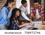 young freelance team working on ... | Shutterstock . vector #758972746