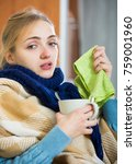 Small photo of Portrait of girl suffering of cold and having stuffy nose