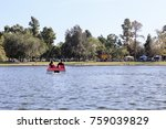 Pedal Boating In A Lake At El...