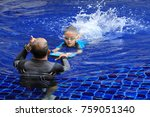 asian boy gets swimming lessons ... | Shutterstock . vector #759051340