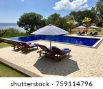 blue pool lounge chairs with... | Shutterstock . vector #759114796