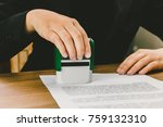 close up hand stamping of... | Shutterstock . vector #759132310