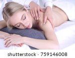 young woman lying on a massage... | Shutterstock . vector #759146008