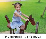 Little Child Girl Riding On A...