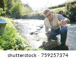 biologist testing water quality ... | Shutterstock . vector #759257374