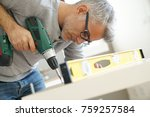 man assembling diy furniture...   Shutterstock . vector #759257584