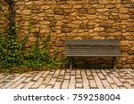 A Bench In Front Of A Stone...