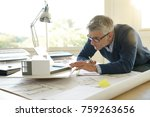 architect in office working on... | Shutterstock . vector #759263656
