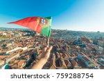 hand holding portuguese flag on ...   Shutterstock . vector #759288754