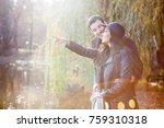 happy smiling couple walking in ... | Shutterstock . vector #759310318