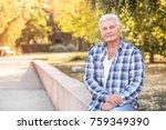 handsome mature man in park | Shutterstock . vector #759349390