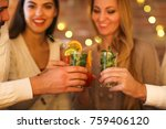 young men and women drinking... | Shutterstock . vector #759406120