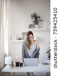 young woman using laptop while...   Shutterstock . vector #759425410