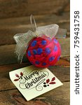 Small photo of Adornment and Merry Christmas note
