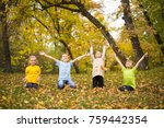 Kids Playing In Park With Leaves