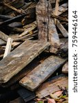 Small photo of Amass of old wooden planks