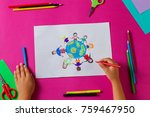 Small photo of Kids draws with pencils and markers peace in the world. Child drawing the friendship of the peoples of the planet.