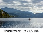 a lone fisherman in a motor... | Shutterstock . vector #759472408