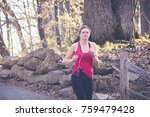 woman running in wooded forest... | Shutterstock . vector #759479428