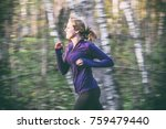 young fit woman running in... | Shutterstock . vector #759479440