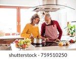 senior couple preparing food in ... | Shutterstock . vector #759510250