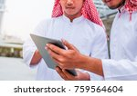 two arabic muslim wear white... | Shutterstock . vector #759564604