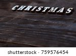 christmas text on a wooden wall | Shutterstock . vector #759576454