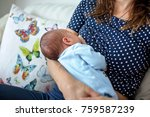young mother breastfeeding  her ... | Shutterstock . vector #759587239