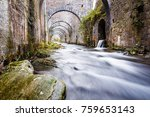 Stock photo stream running through a disused and abandoned weapon factory of orbaiceta near the irati green 759653143
