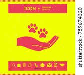 hand holding paw symbol. animal ... | Shutterstock .eps vector #759674320