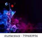 Stock photo martini cocktail splashing in blue and purple smoky background 759683956