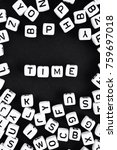 Small photo of Time. Word made of white beads on black background. a series of minimalism phrases and words.