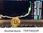 Small photo of golden bitcoin on keyboard with chart