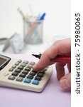 hand and a calculator | Shutterstock . vector #75980065
