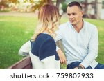 couple talking outdoors in a... | Shutterstock . vector #759802933