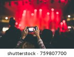 taking photo at a music concert | Shutterstock . vector #759807700