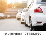 Stock photo white car parked neatly inside an outdoor parking lot 759883990