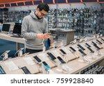 happy male customer choosing... | Shutterstock . vector #759928840