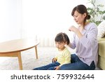 mother tieing child's hair... | Shutterstock . vector #759932644