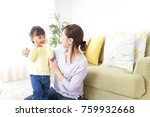 mother tieing child's hair... | Shutterstock . vector #759932668