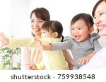 two mothers carrying  children... | Shutterstock . vector #759938548