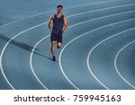 young man sprinting on a blue... | Shutterstock . vector #759945163