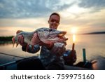 happy angler holds pike fish... | Shutterstock . vector #759975160