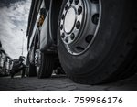 Maintaining Semi Truck Tires Concept Photo. Trucking Industry. - stock photo