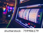 Spinning Drums of Slot Machine Inside the Casino. Modern Digital One Handed Bandit Game. - stock photo
