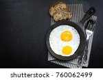 fried eggs fried in a frying... | Shutterstock . vector #760062499