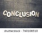 Small photo of Conclusion word by wood letters on wood background