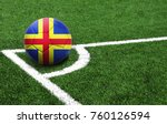 Small photo of The flag of Aland is depicted on a football, with a good place for your text
