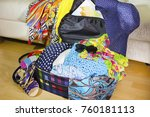 open suitcase with clothes and... | Shutterstock . vector #760181113
